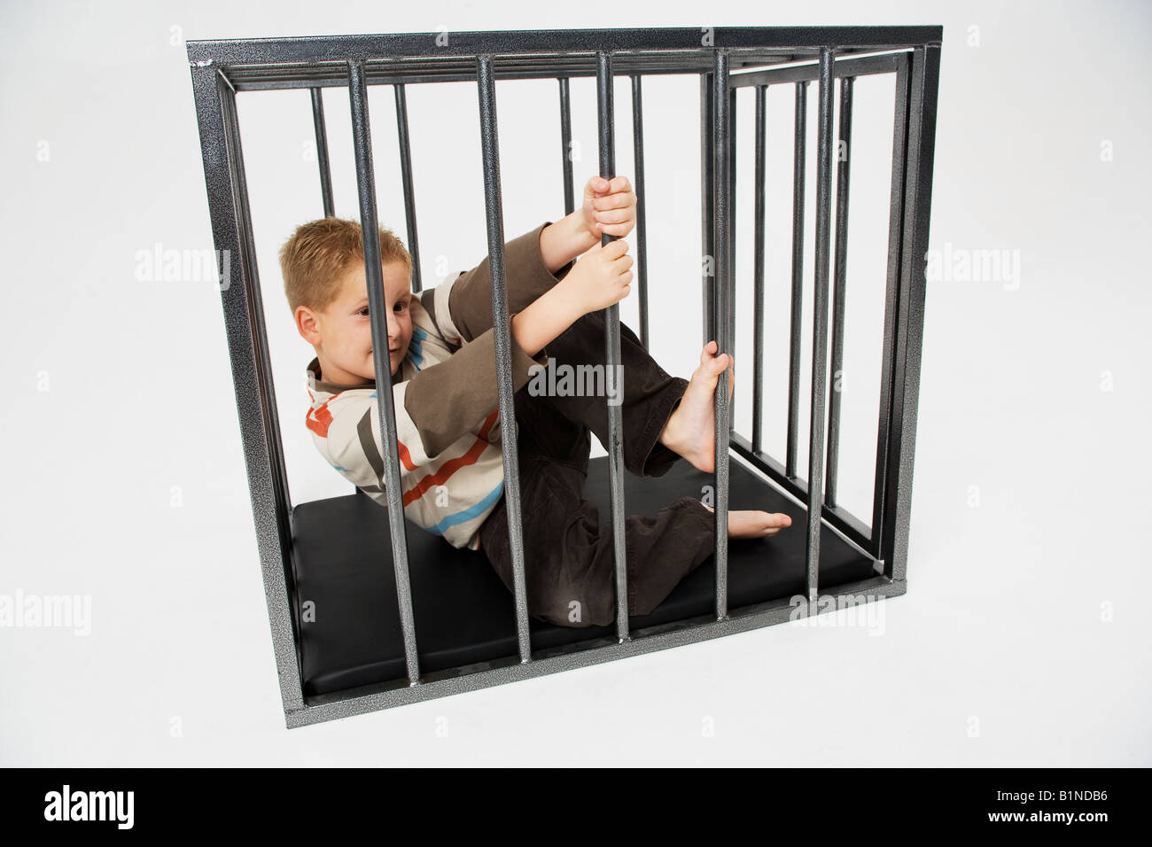Cameron Breaking out of Cage - Stock Image