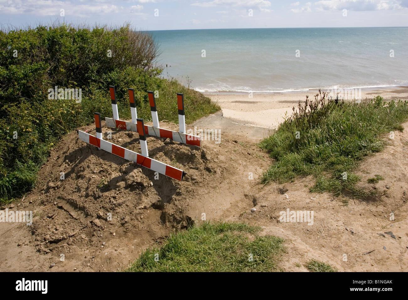 Blocked road collapsed after severe coastal erosion Happisburgh North Norfolk Coast UK - Stock Image