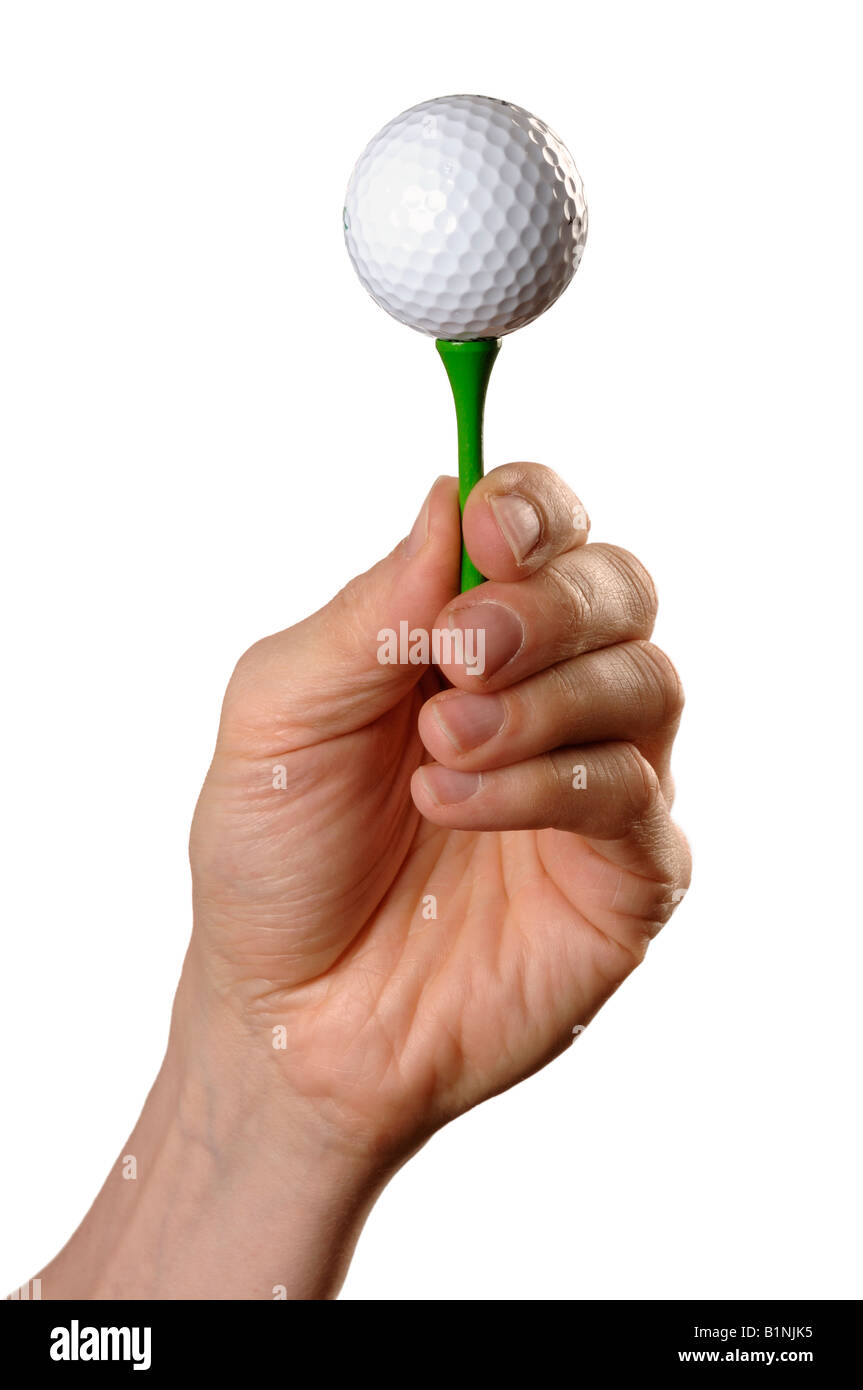 Mans hand holding a golf ball on a tee - Stock Image