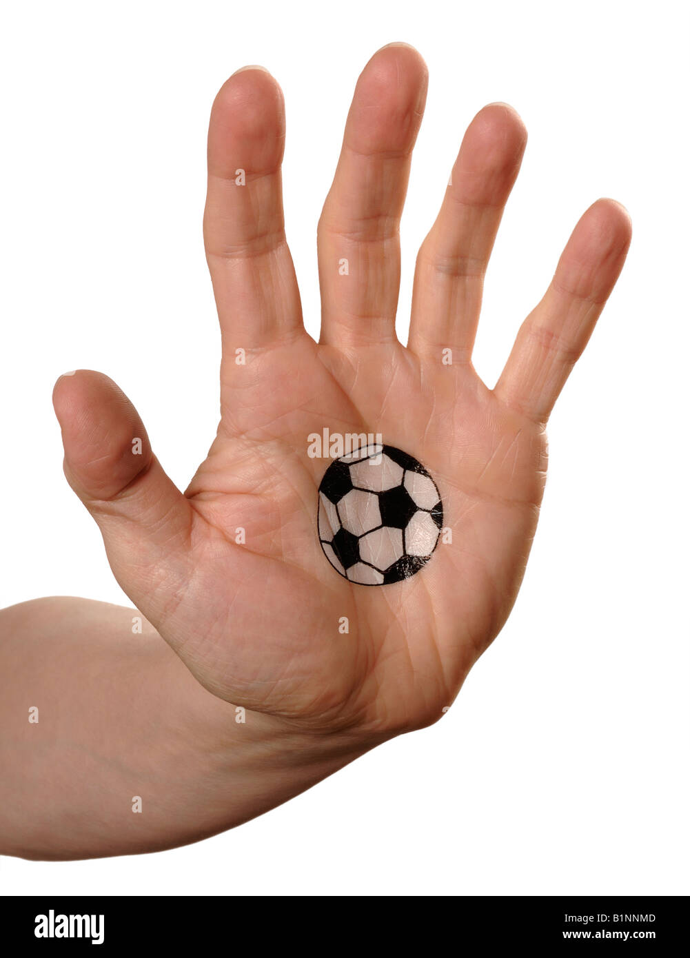 Mans hand with football on palm - Stock Image