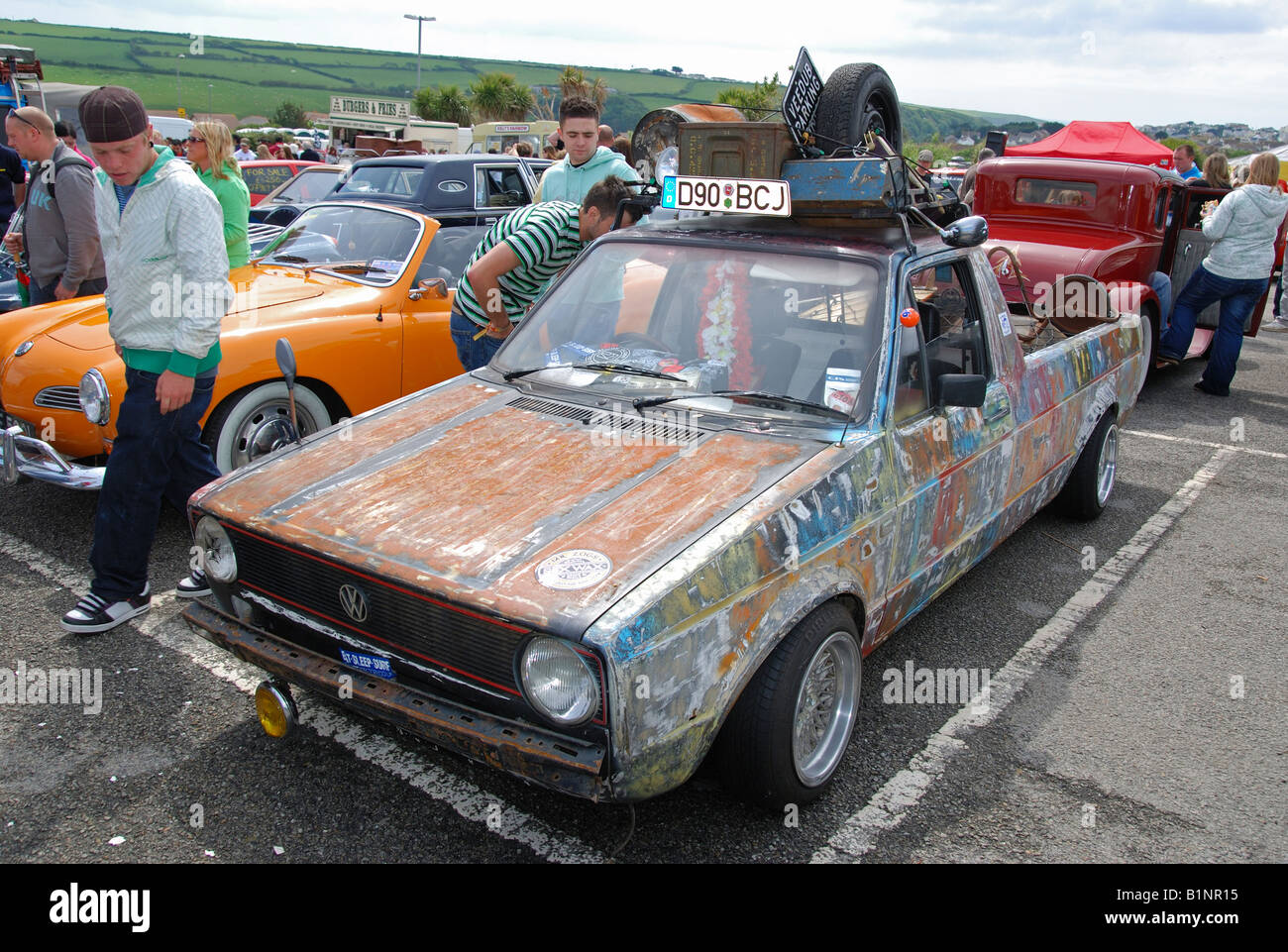 a 'grunged' volkswagen golf at the 'run to the sun' event at newquay in cornwall,england - Stock Image
