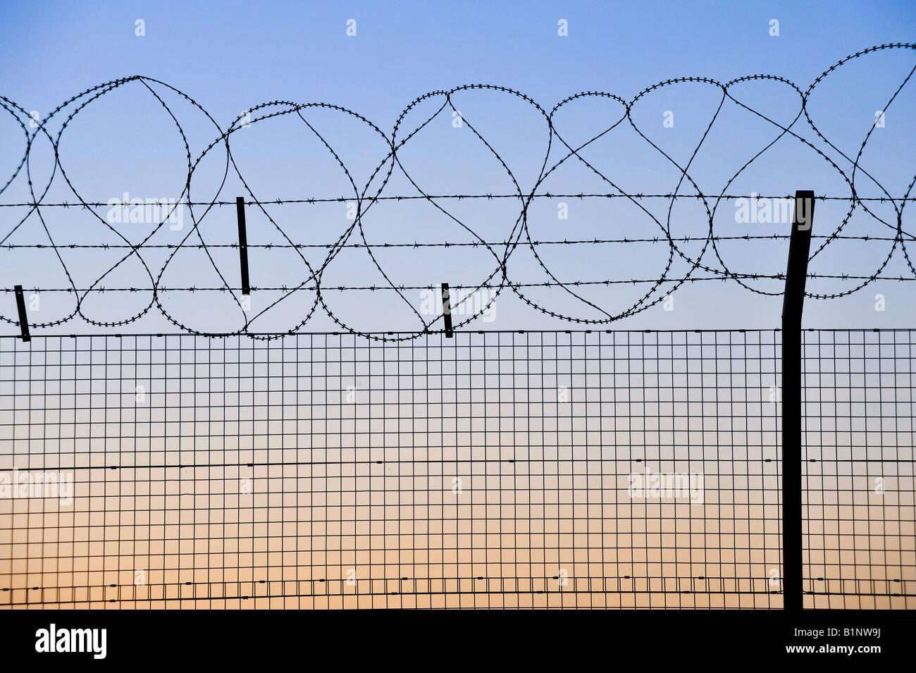 Razor wire security fence at sunset Edinburgh Stock Photo: 18305886 ...