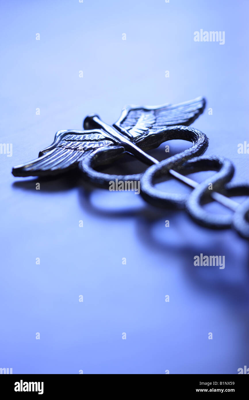 Caduceus medical symbol blue tone - Stock Image