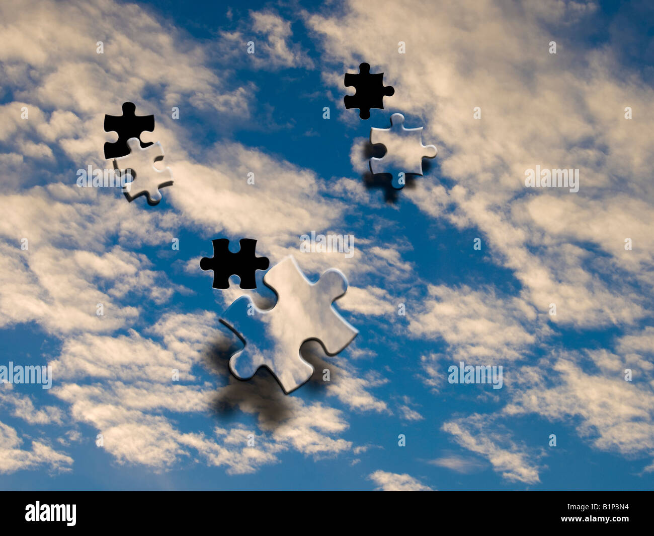 Blue sky image with jigsaw effect - Stock Image