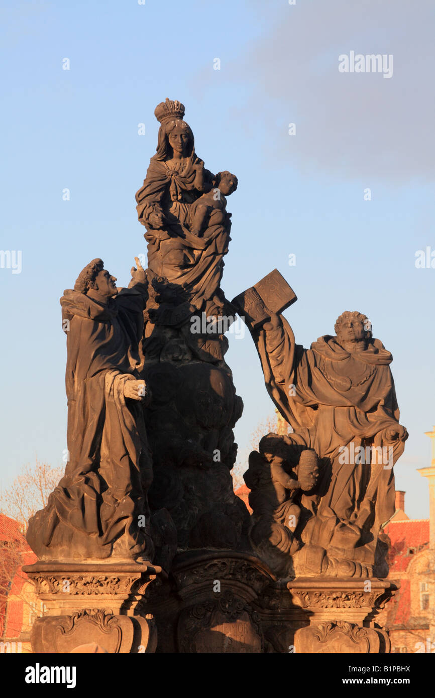 St Dominic and St Thomas Aquinas with the Virgin Mary  by Jackel on the Charles Bridge in Prague Czech Republic Stock Photo