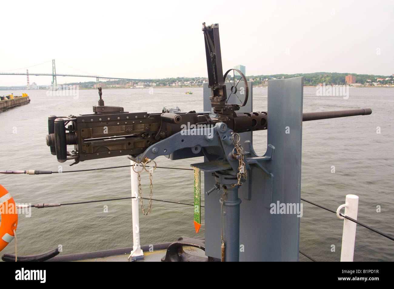 A .50 calibre machine gun mounted at the stern of a Canadian warship. - Stock Image