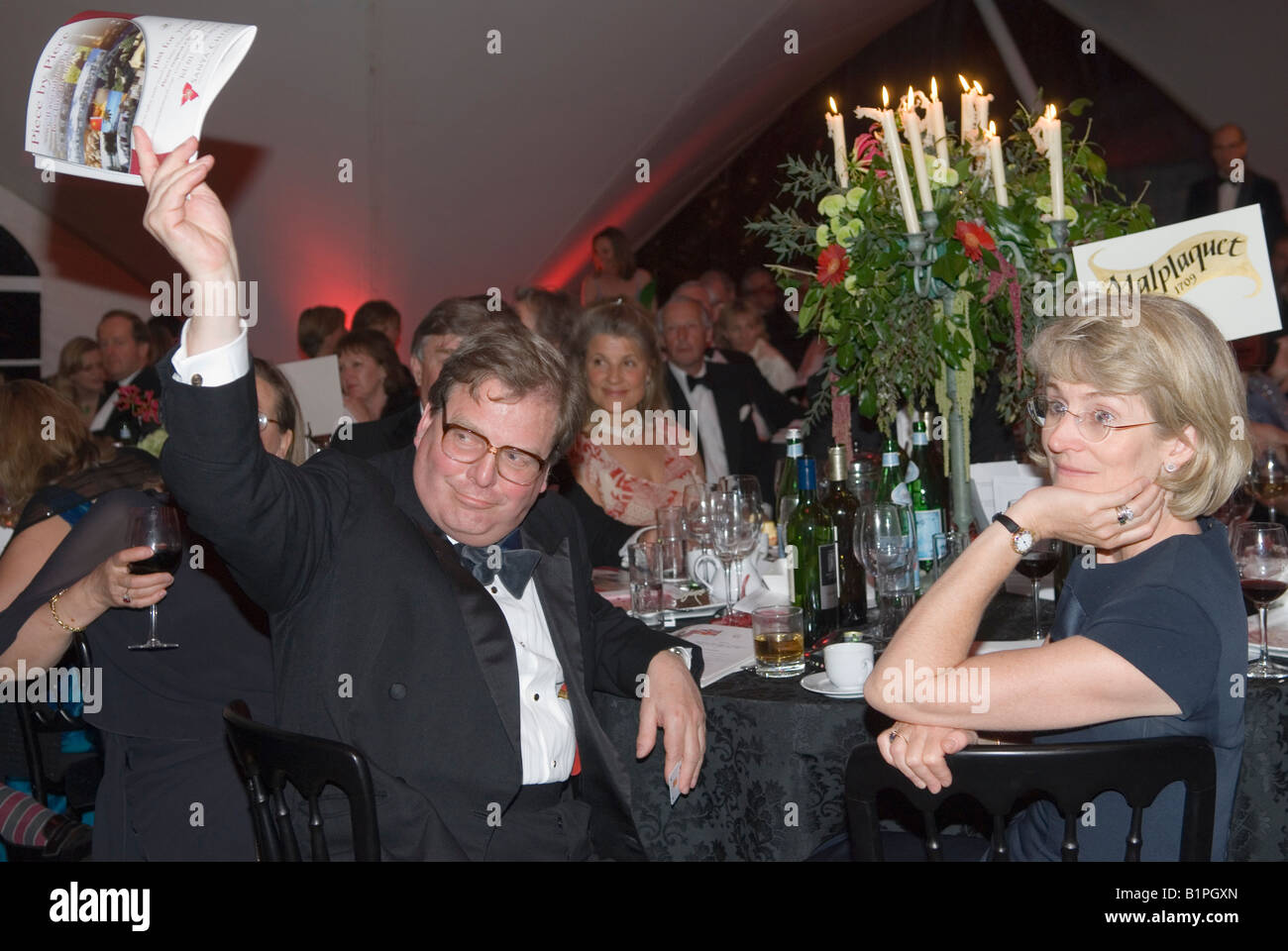 Black tie charity auction event reception Hampshire Uk Wealthy lifestyle  2010s Britain UK HOMER SYKES - Stock Image
