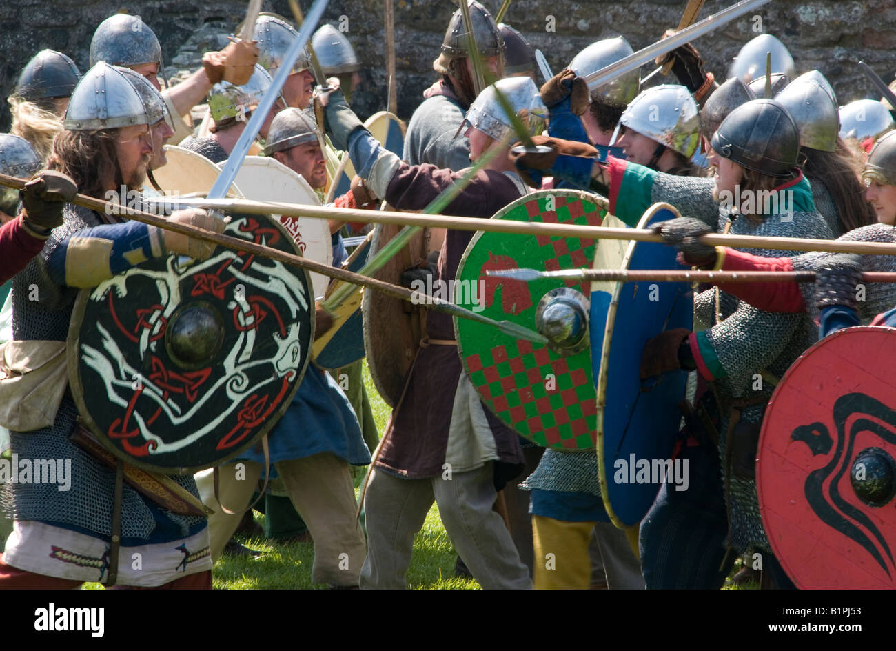 Vikings from a re enactment group on Lindisfarne which the real vikings famously invaded in AD794 - Stock Image