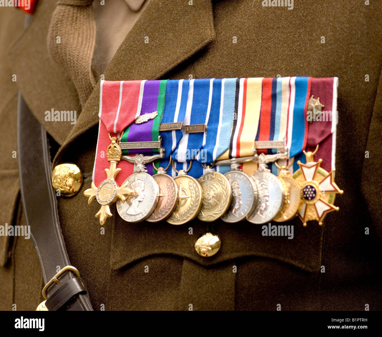 a row of campaign medals including the george cross pinned