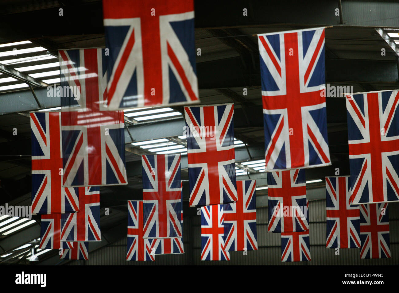 Union Jack Flags hang in the QE2 terminal in Southampton docks - Stock Image