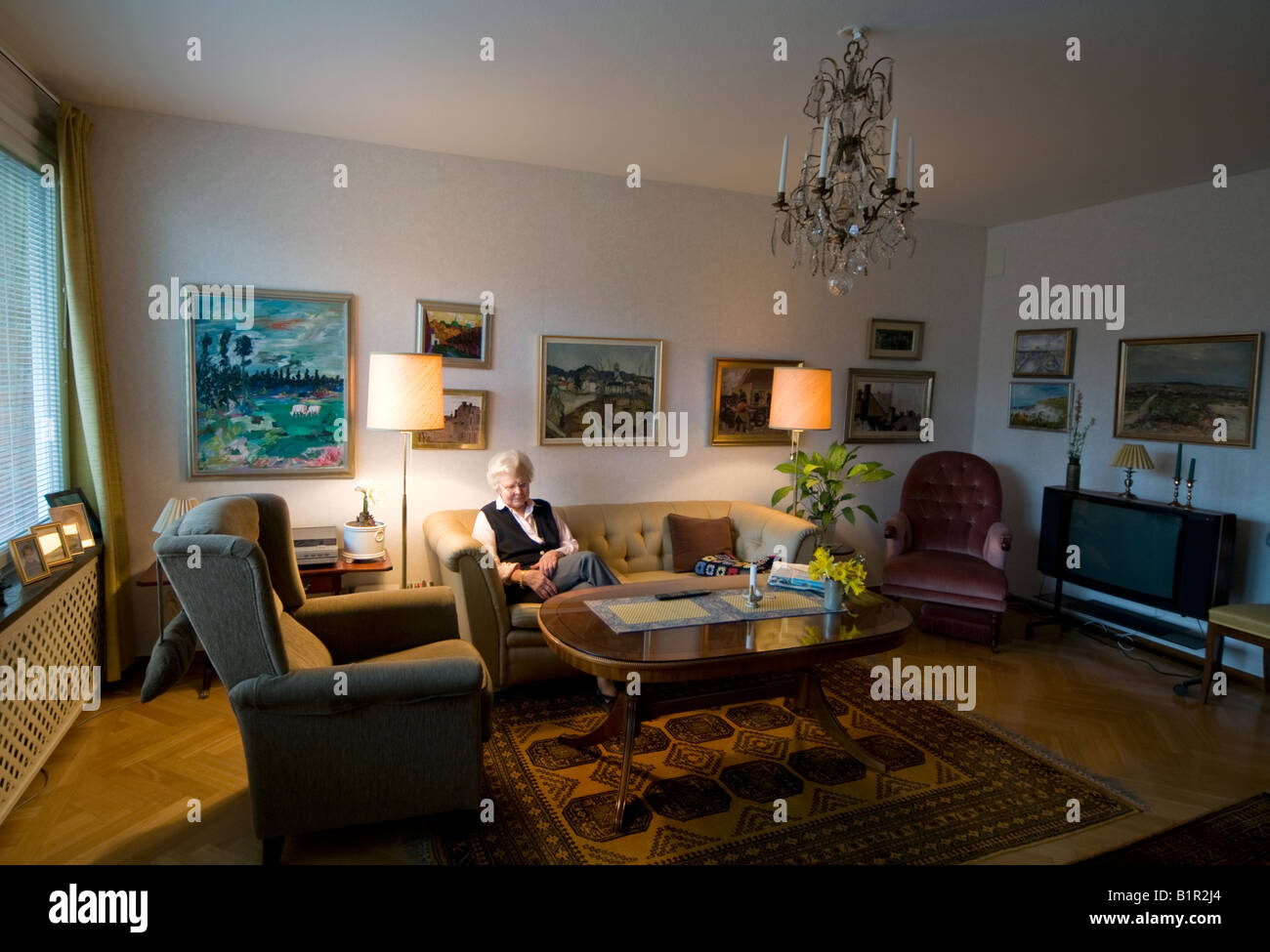 Old woman in her living room - Stock Image
