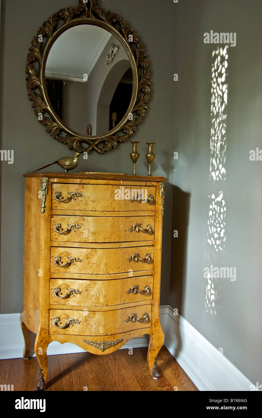 Antique Chest Of Wooden Oak Drawers Ornate Framed Mirror Stock Photo