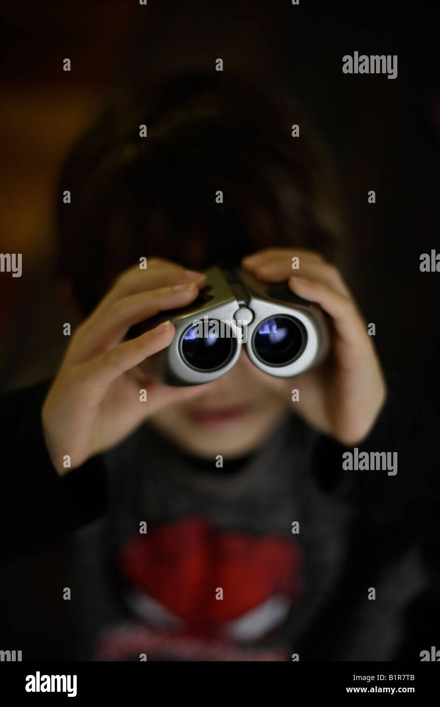Child with binoculars boy aged six years - Stock Image