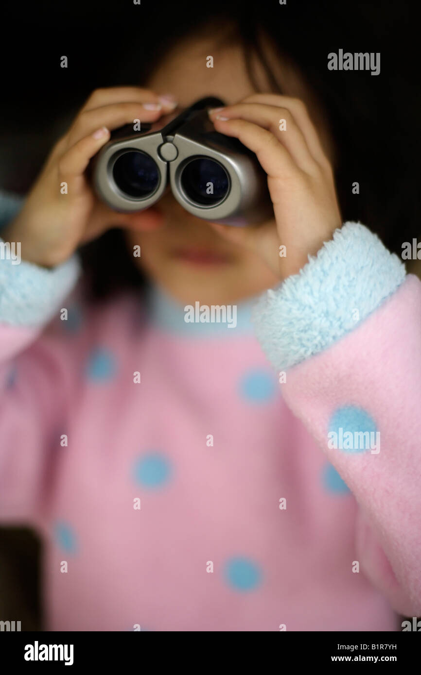 Child with binoculars girl aged four years - Stock Image