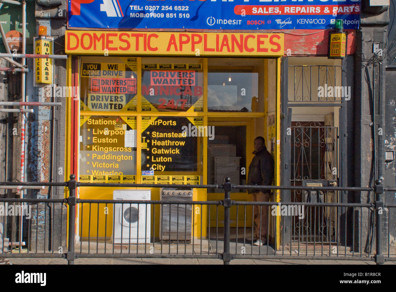 A rundown shop selling white goods on Dalston Lane, in the inner city Borough of Hackney London - Stock Image