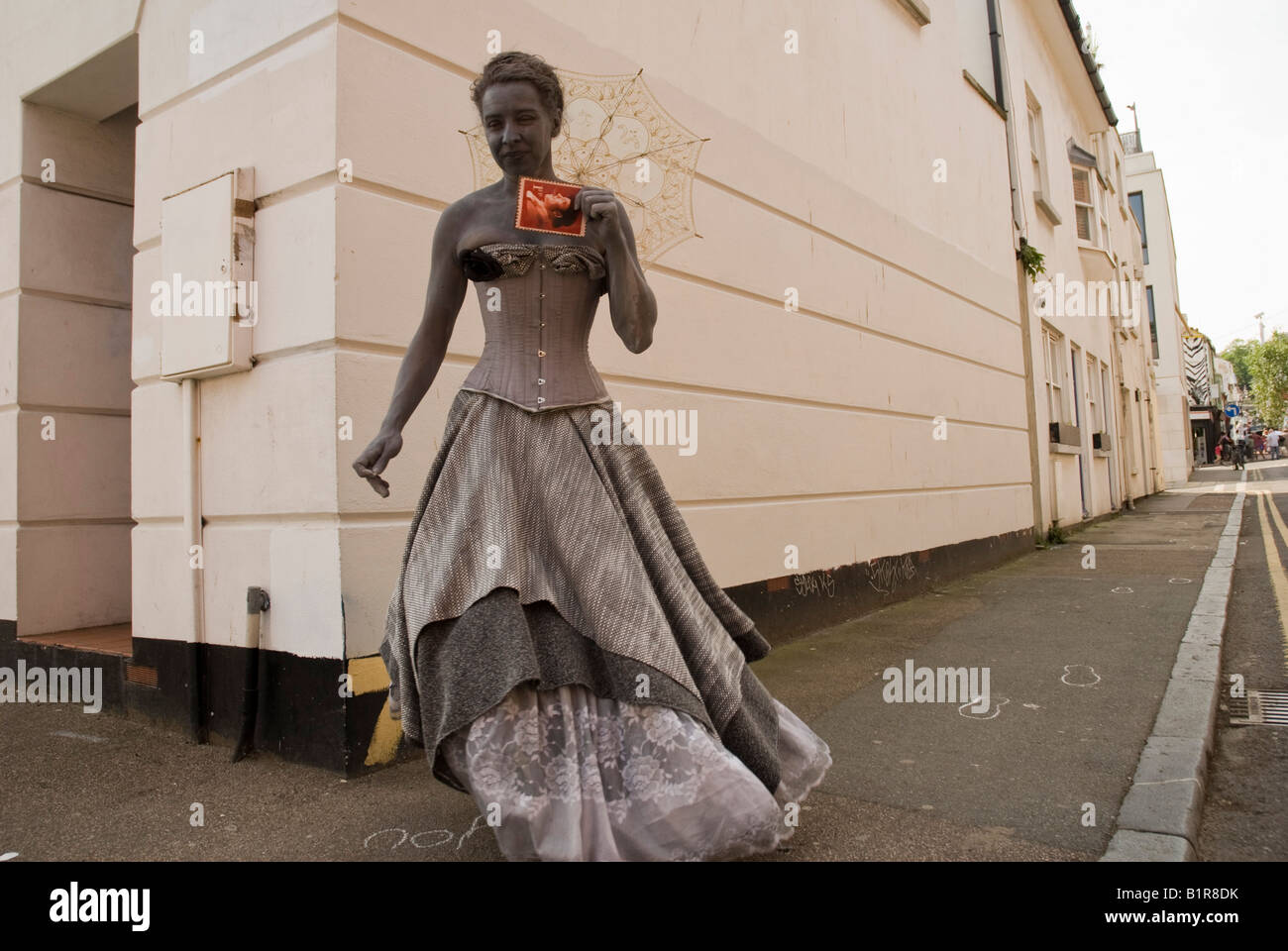A woman Actor performing street theatre in Brighton - Stock Image