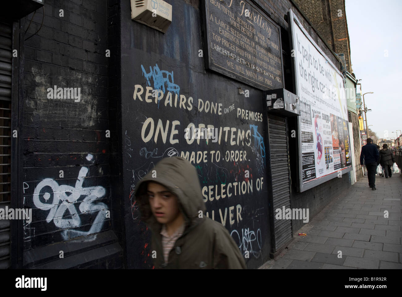 A young boy passes thorough a run down inner city area of Dalston Hackney - Stock Image