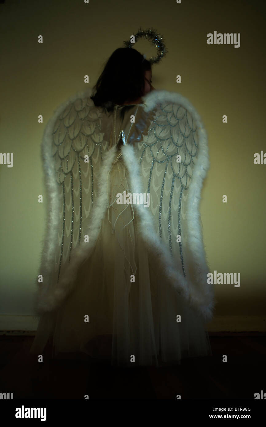 Girl aged four in angel costume - Stock Image
