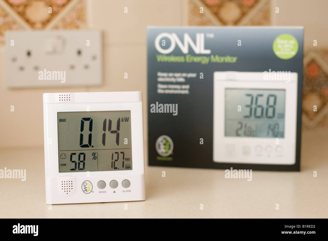 Owl energy monitor measuring electricity use UK - Stock Image