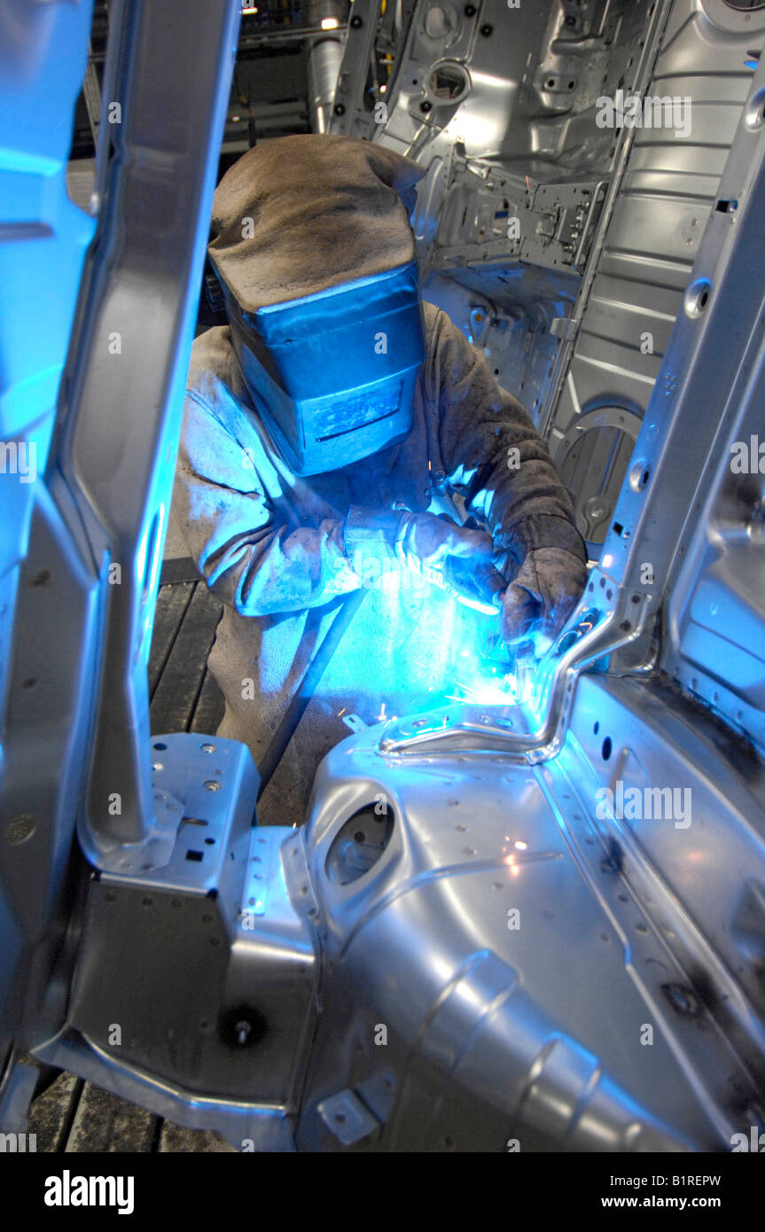 Manual welding, coachwork factory, production of the BMW 1 and 3 Series, BMW car plant in Regensburg, Bavaria, Germany, - Stock Image