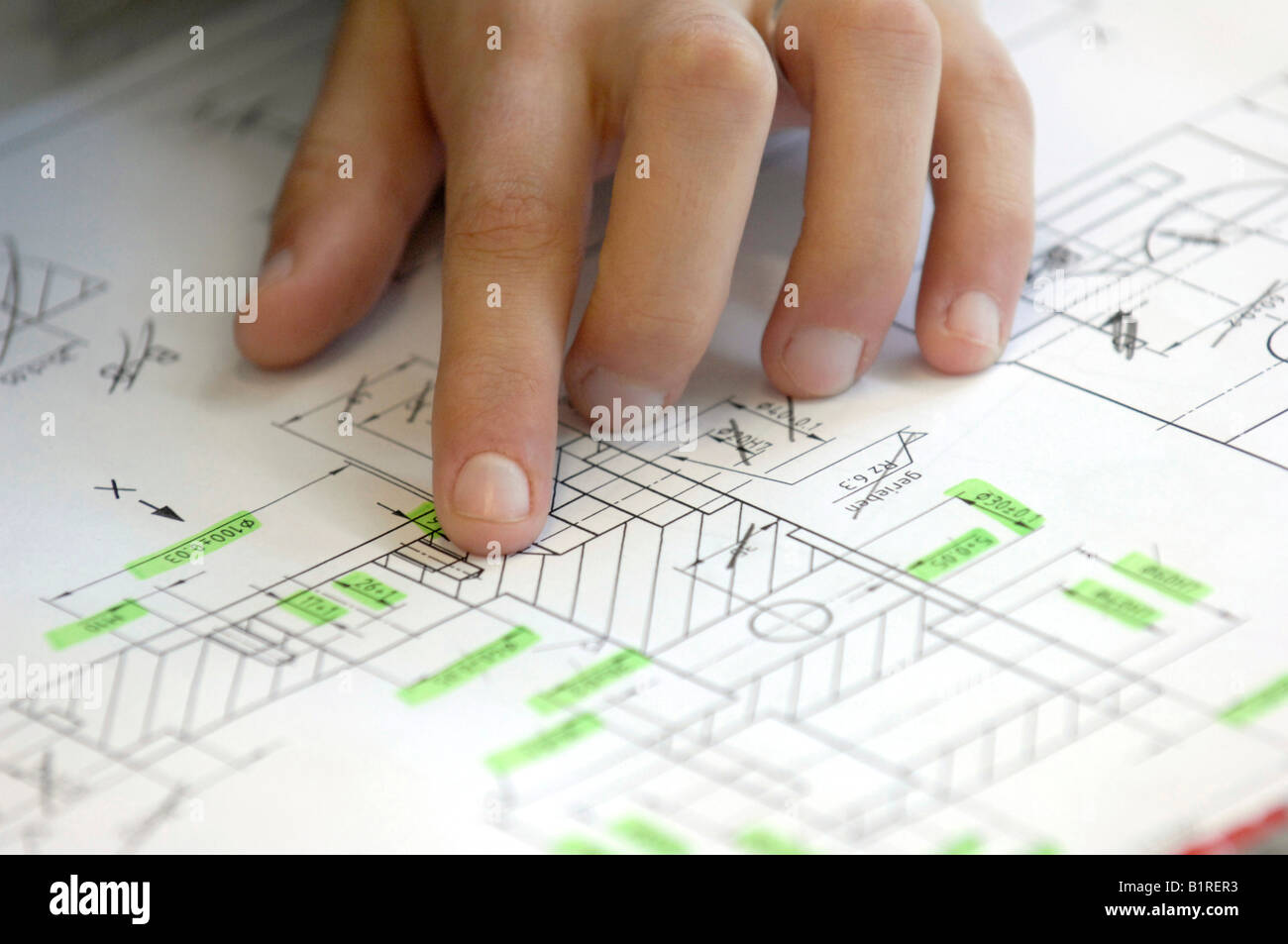 Draftswoman with her hand on a construction plan, blueprints, layout, Heidenheim, Baden-Wuerttemberg, Germany, Europe - Stock Image