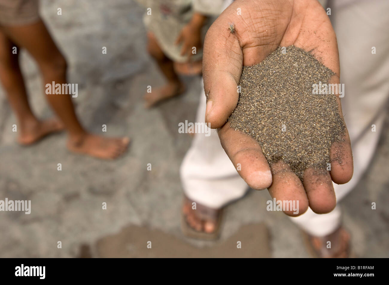 Copper shavings washed by hand from toxic industrial slag, earning a living from recycling waste in the slums of - Stock Image