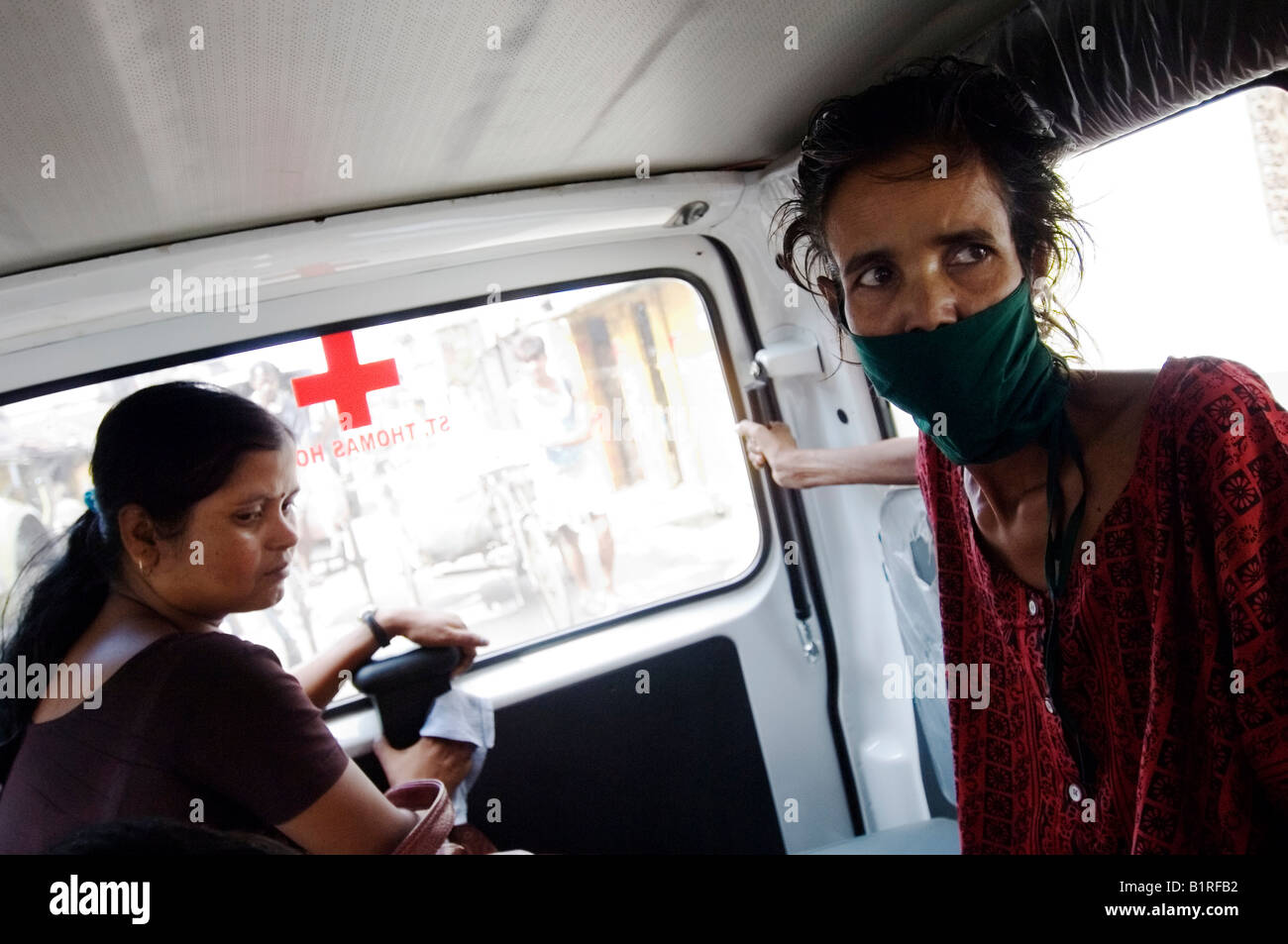 Najira Begum, 35, diagnosed with multi-resistant tuberculosis, in an ambulance with a female social worker on the way to an x-r Stock Photo