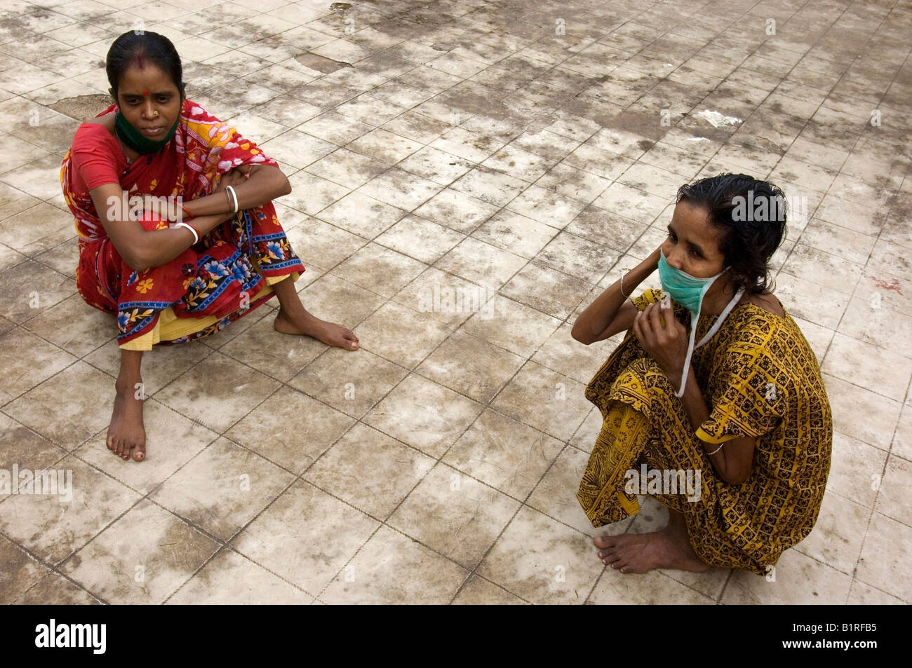 Multi-resistant tuberculosis patients Radha Devi, 30, left, and Najira Begum, 35, sitting on the roof terrace of the quarantine Stock Photo