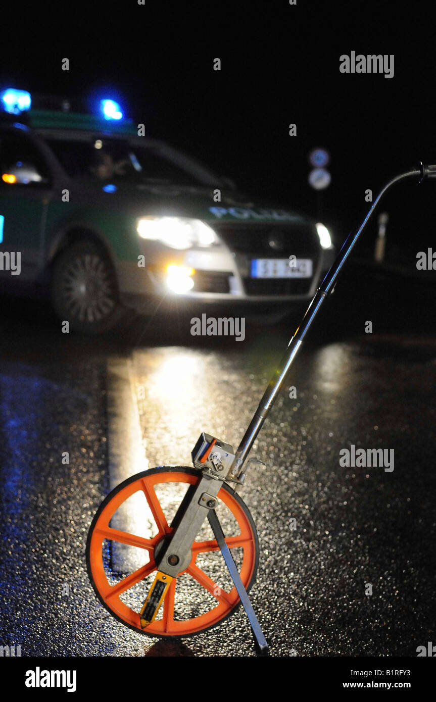 Distance measuring device for the acquisition of accident data in front of a police patrol car at the scene of a - Stock Image