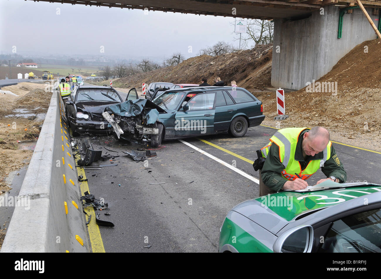 Police officer during the acquisition of accident data of a car accident, Nuertingen, Esslingen Region, Baden-Wuerttemberg, - Stock Image