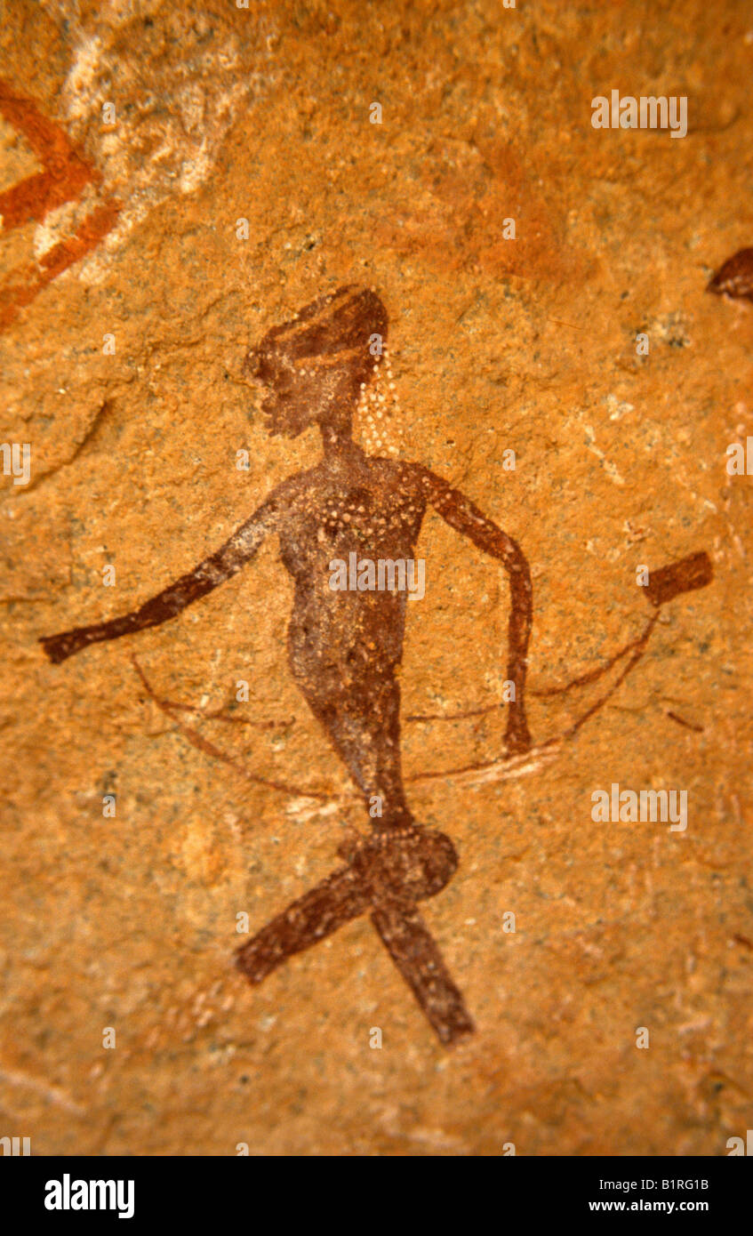 Pictograph, rock painting of a woman wearing a headdress made of ostrich eggshells, Brandberg, Namibia, Africa - Stock Image