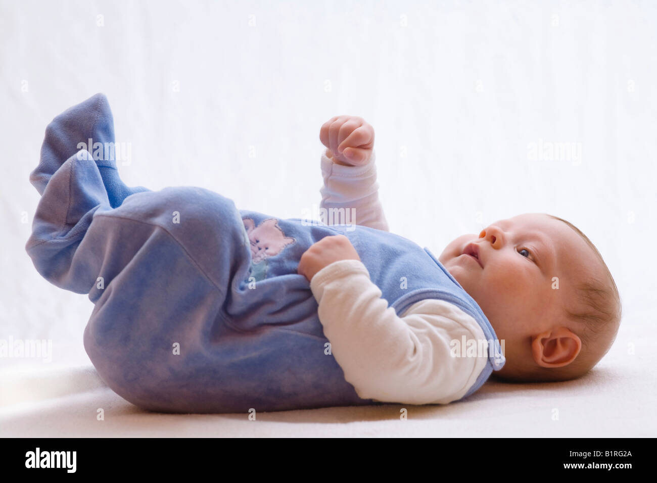 3-month-old baby, stretching arms into the air - Stock Image