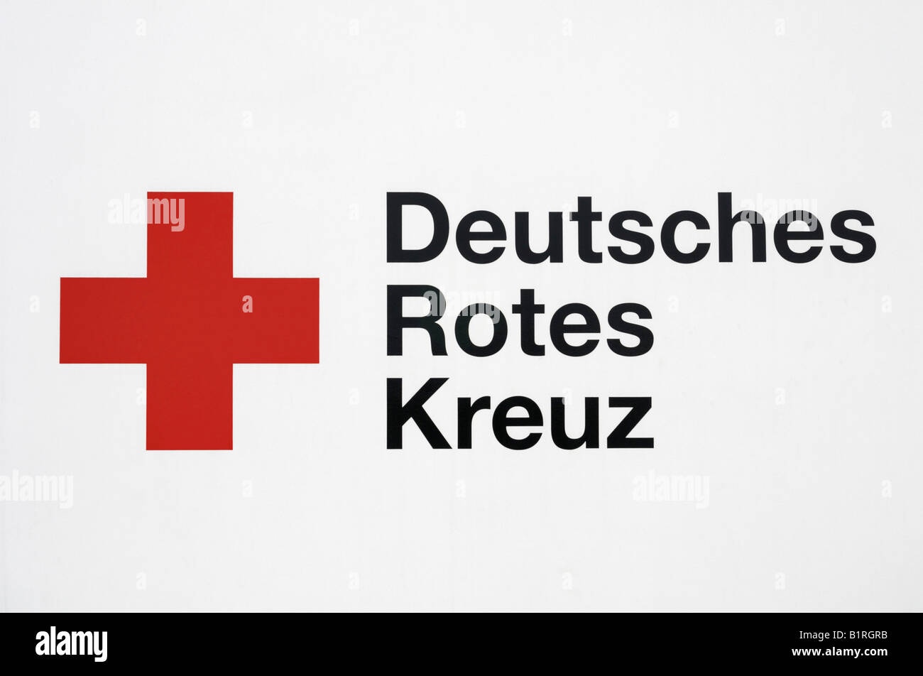 Emblem and lettering of Deutsches Rotes Kreuz, German Red Cross - Stock Image