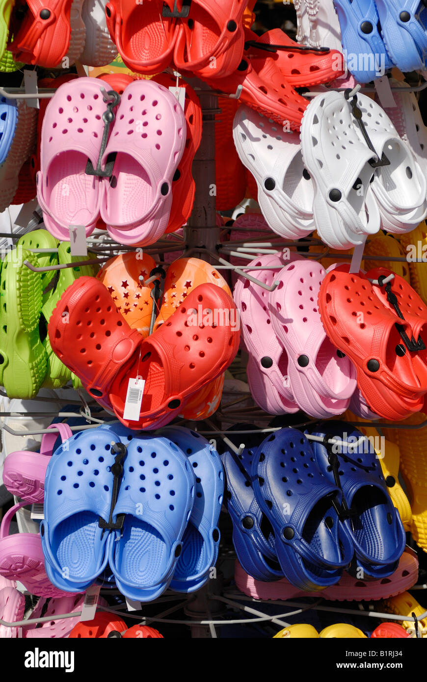 Crocs hung up on a stand, Germany, Europe - Stock Image