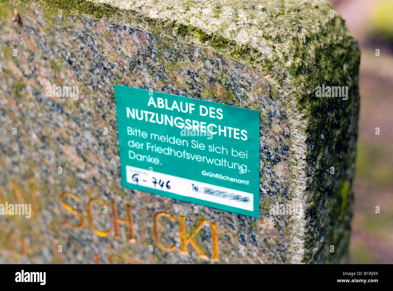 Sticker on a gravestone, right of use has expired, from urban green space planning office, cemetery management Germany, Stock Photo