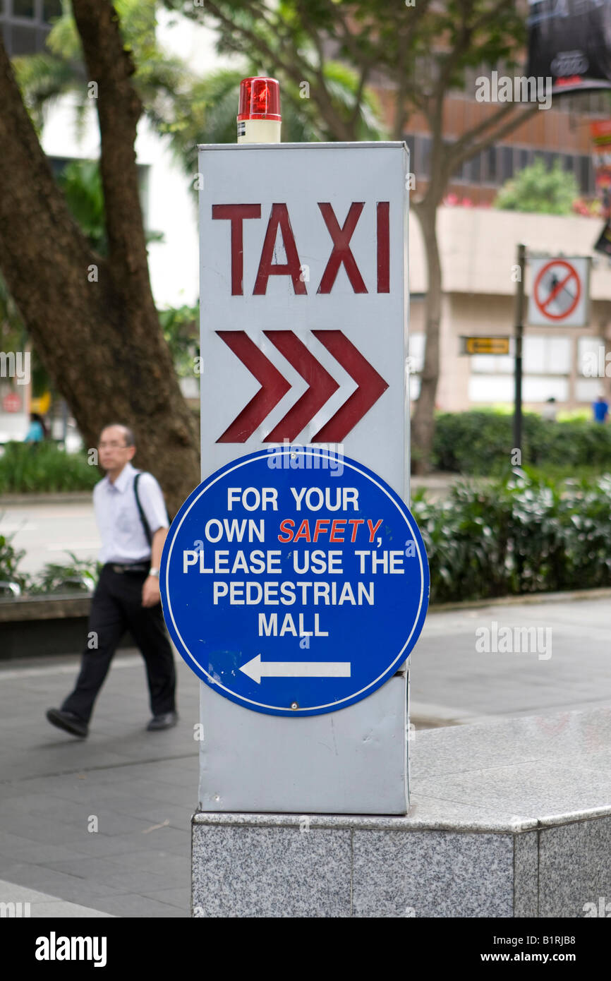 Taxi sign in front of a hotel in Singapore, Southeast Asia - Stock Image