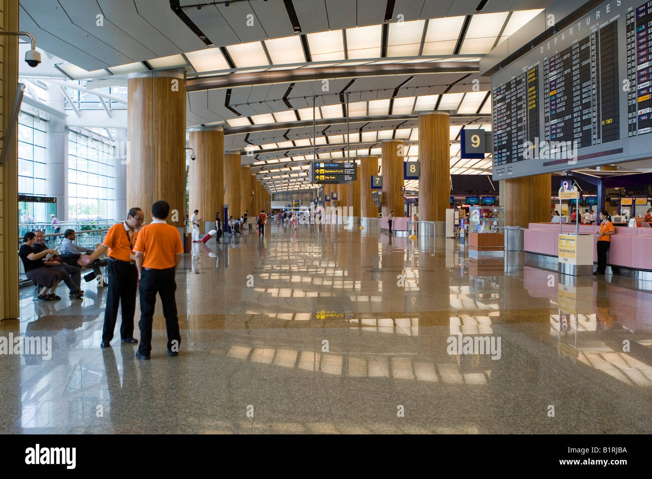 Departure hall and check-in counters at Changi Airport, Singapore, Southeast Asia - Stock Image