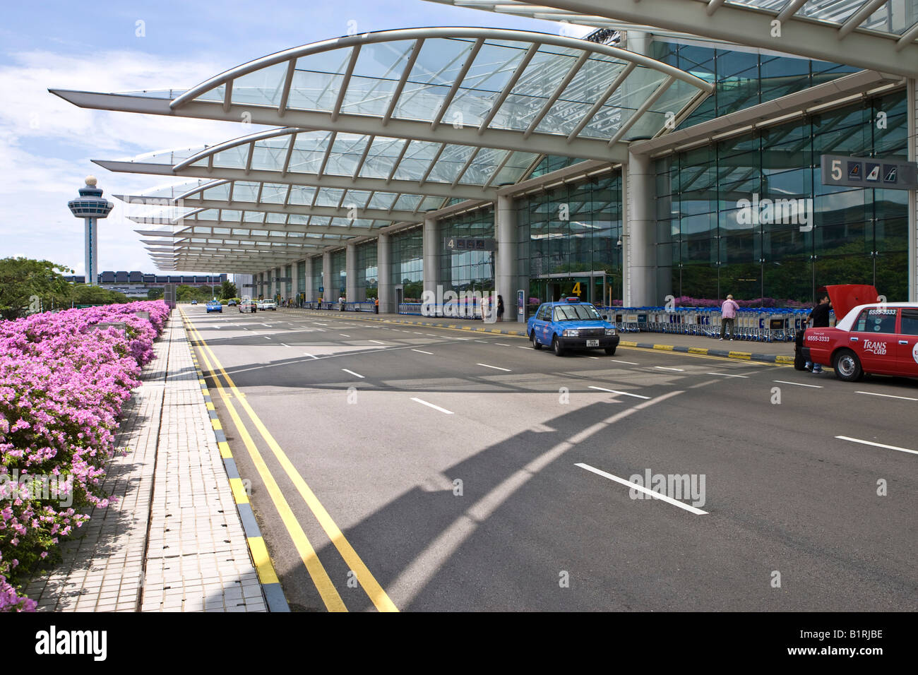 Taxis waiting in front of the Changi Airport, Singapore, Southeast Asia - Stock Image