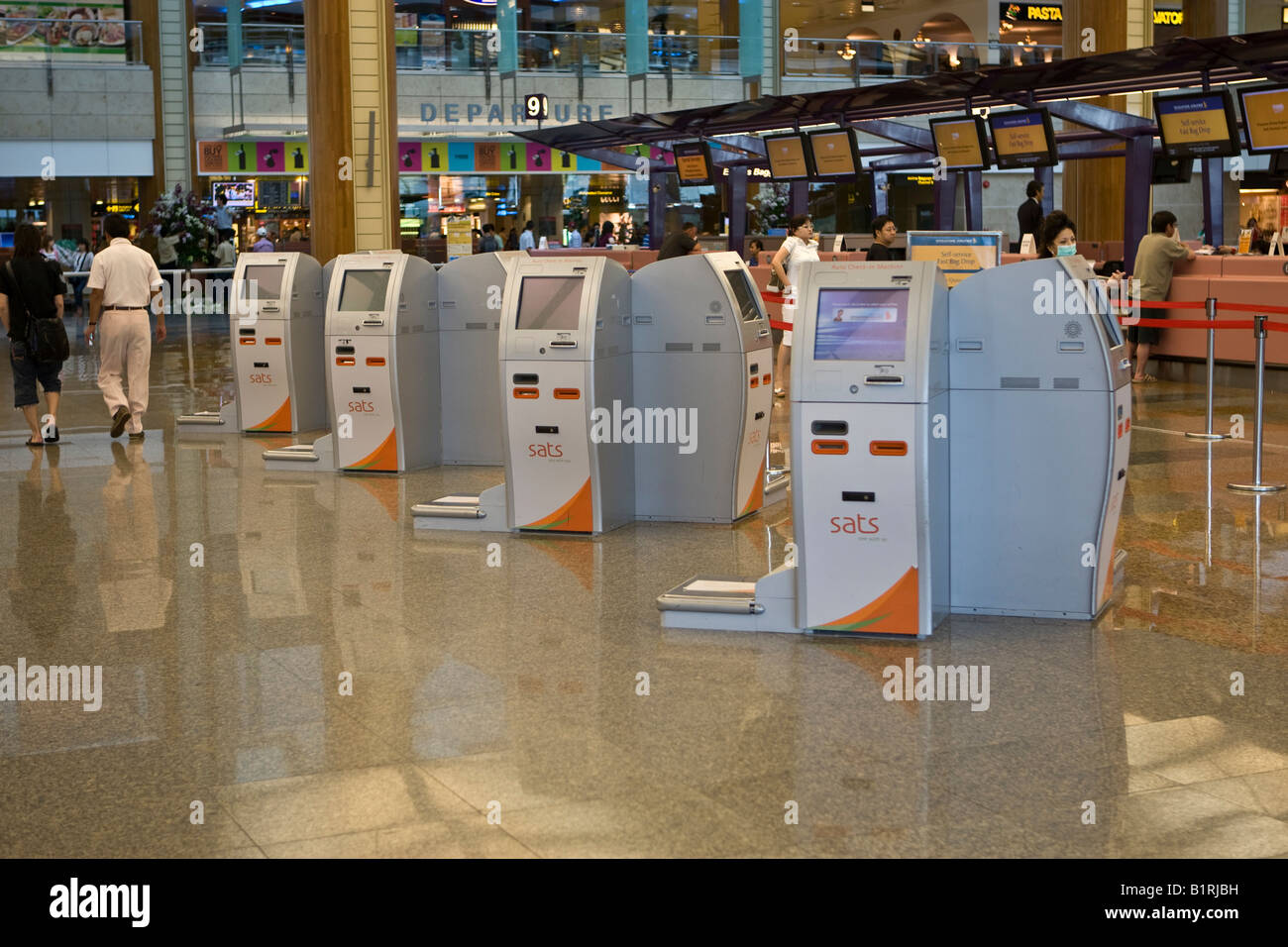 Self check-in terminals in the departures hall of Changi Airport, Singapore, Southeast Asia - Stock Image