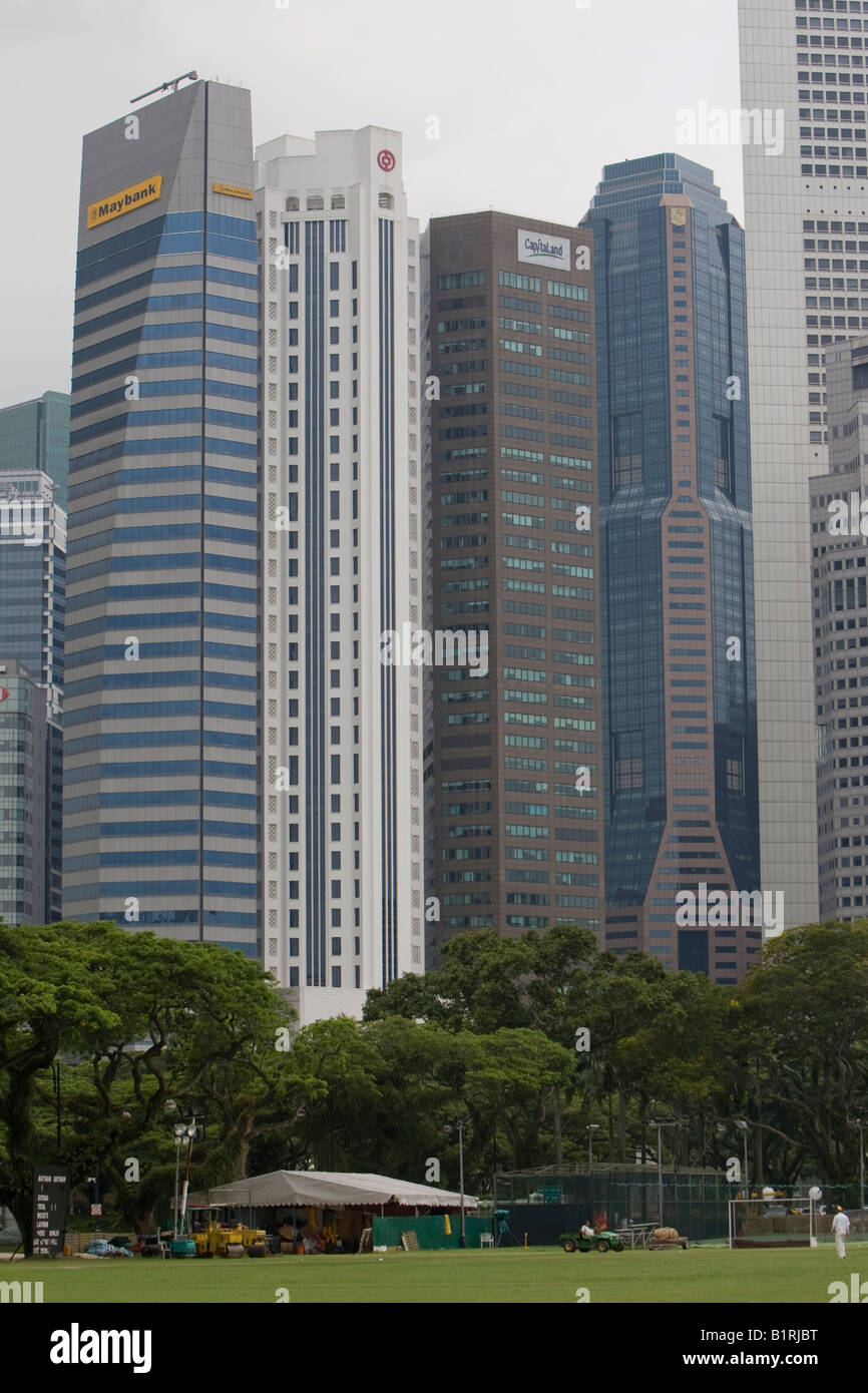 Skyscrapers of the Financial District behind the cricket pitch of the 1852 established Singapore Cricket Club, Singapore, - Stock Image