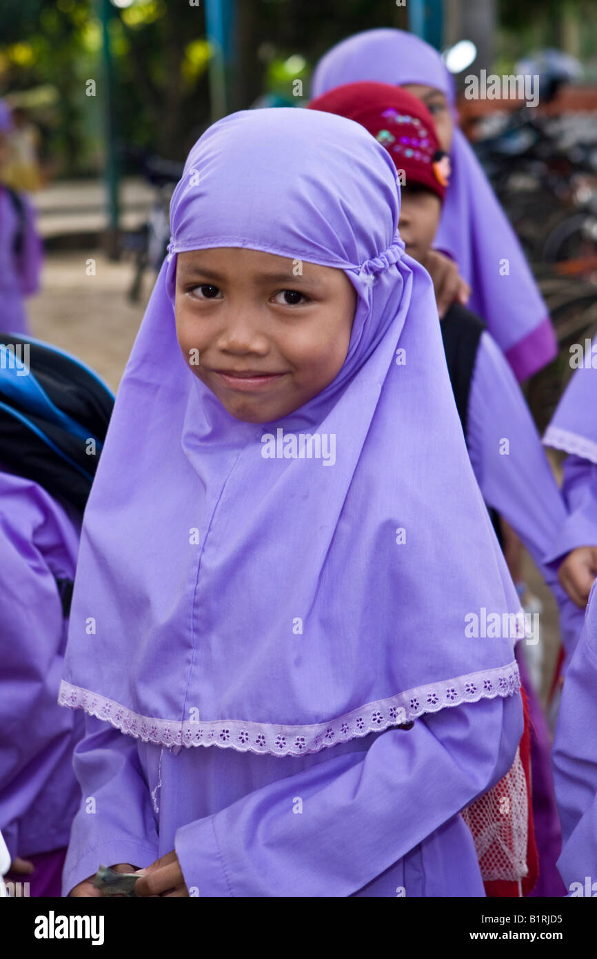 Muslim schoolchildren in front of a school in Mataram, the capital of Lombok Island, Lesser Sunda Islands, Indonesia, Stock Photo