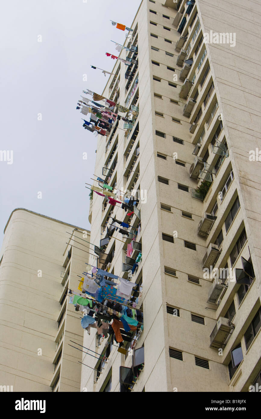 Laundry hung out dry on stock photos laundry hung out dry on stock laundry hung out to dry on rods extended from a high rise building building solutioingenieria Images
