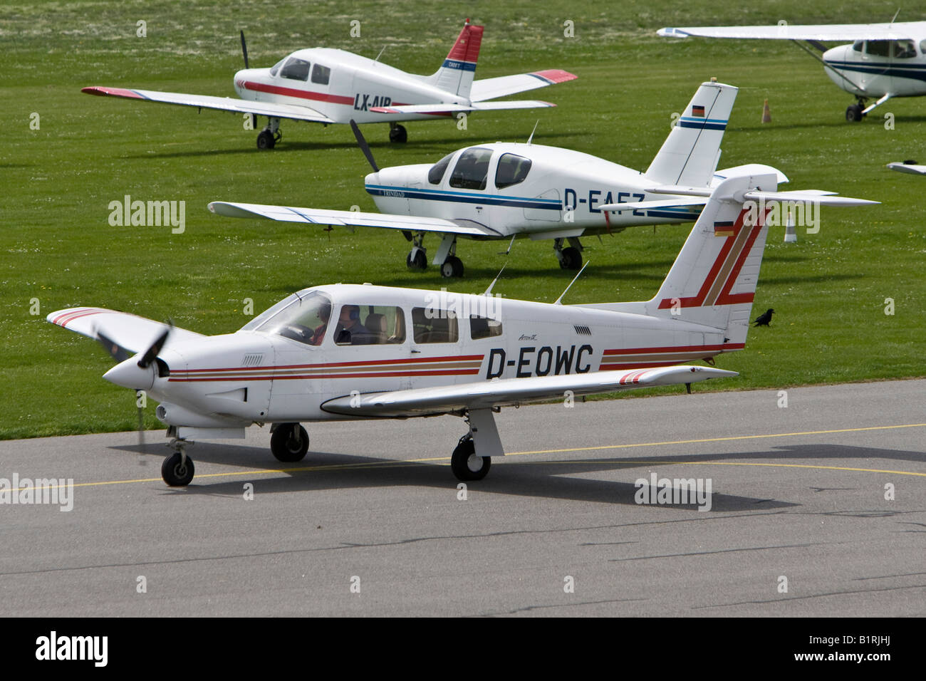 Small sports aeroplane taxiing on the runway of Mannheim Airport, Baden-Wuerttemberg, Germany, Europe - Stock Image