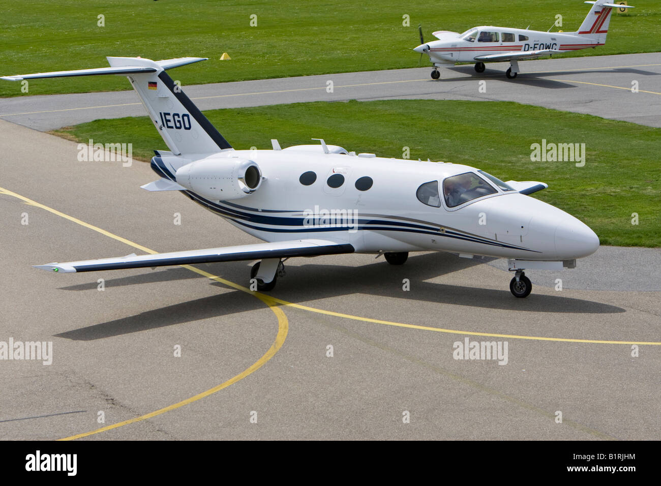 Small, twin-engined business jet taxiing on the runway of Mannheim Airport, Baden-Wuerttemberg, Germany, Europe - Stock Image