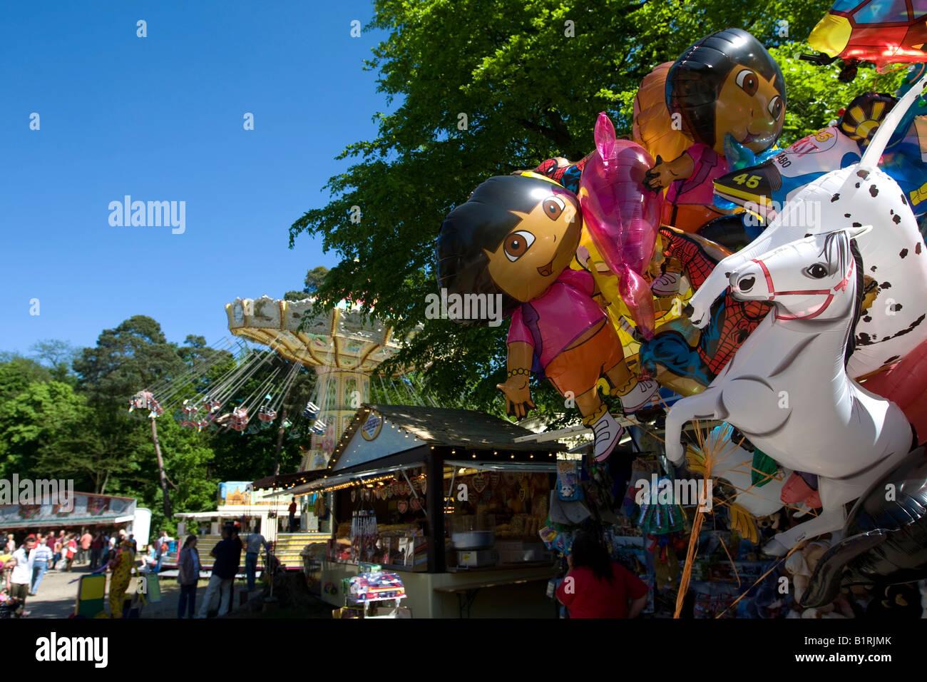 Balloons, chain carousel at back, traditional Waeldchestag, Frankfurt, Hesse, Germany, Europe Stock Photo