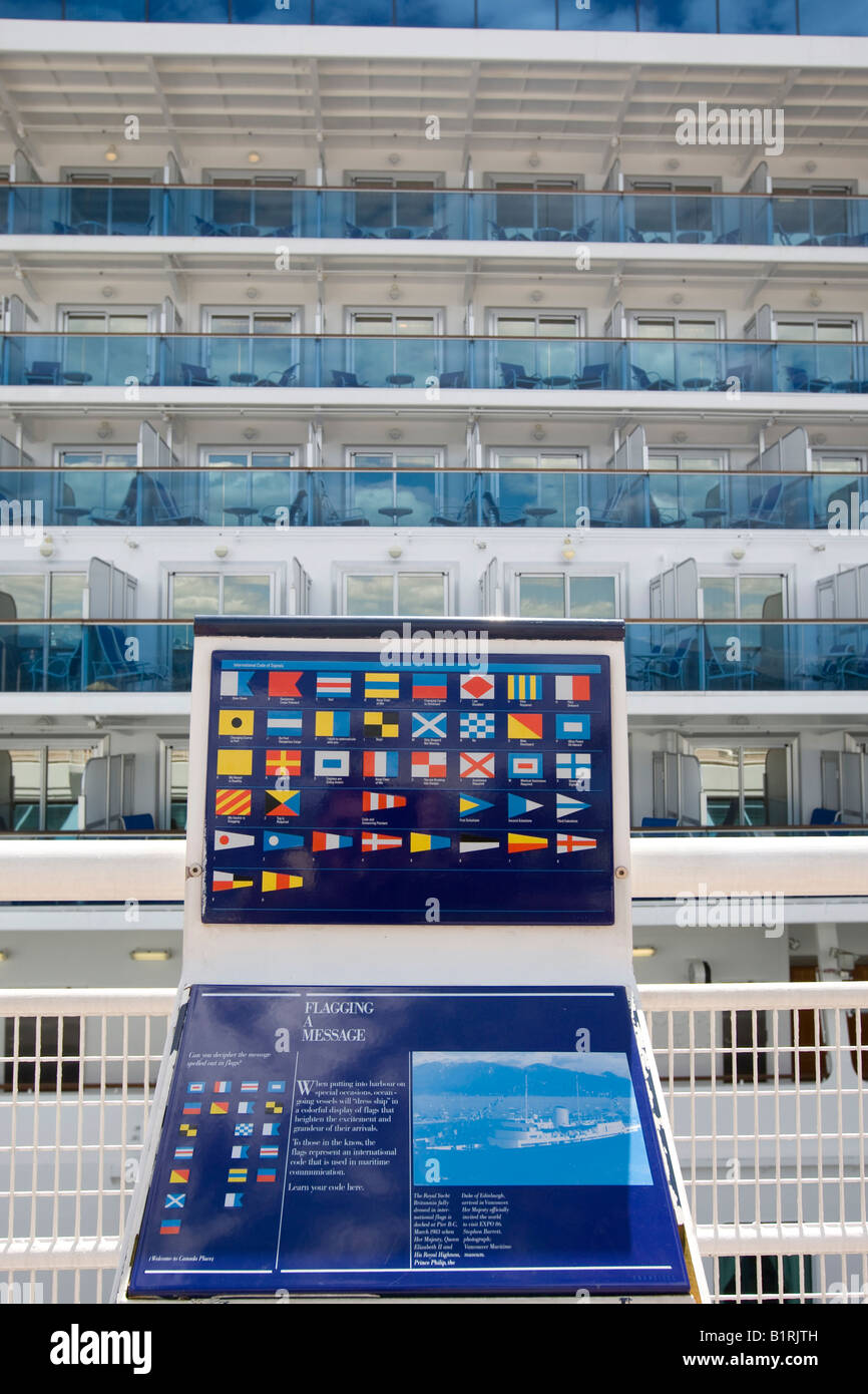 Display showing maritime signal flags, at back the passenger cruise liner 'Diamond Princess', docked in - Stock Image