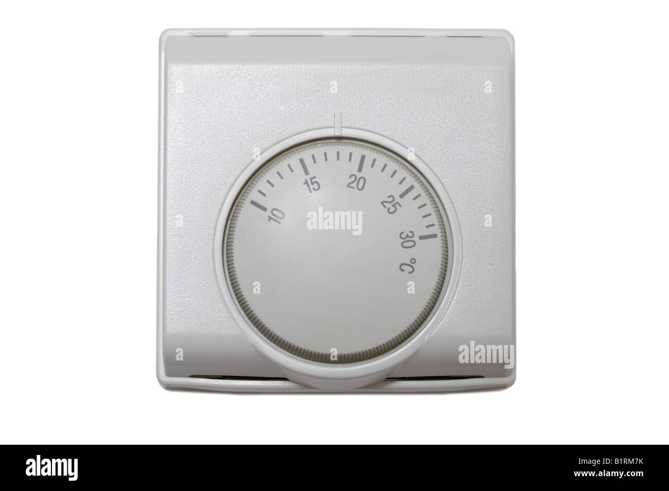 Central heating thermostat control isolated on a white background - Stock Image
