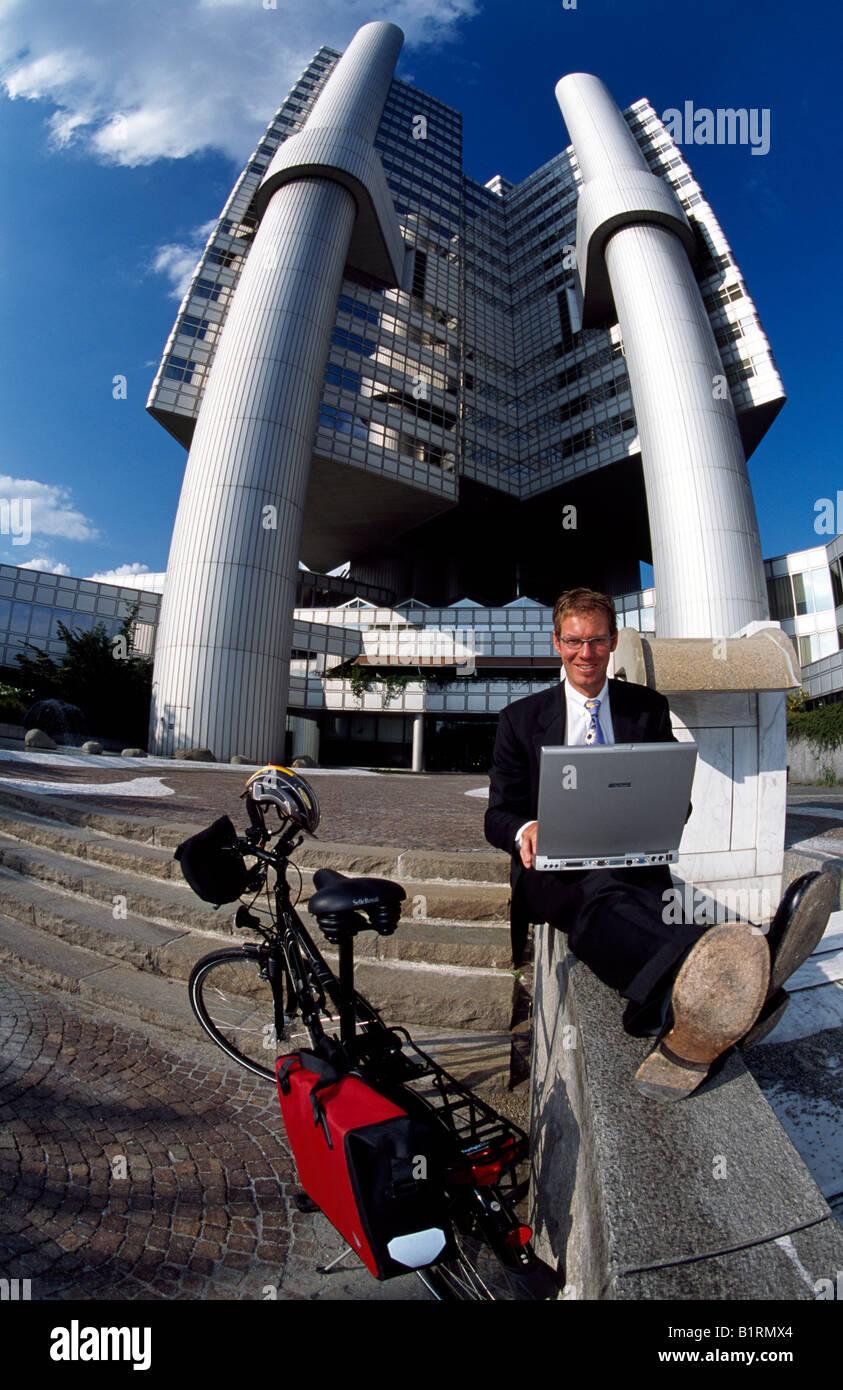 Businessman, biker, Hypo-Haus, Bogenhausen, Munich, Bavaria, Germany - Stock Image