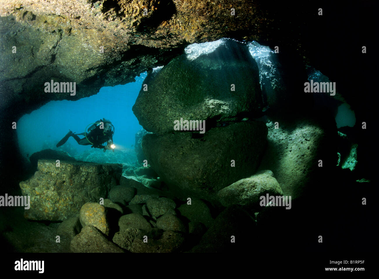Scuba diver exploring an underwater cave, Musandam, Oman, Middle East, Indian Ocean - Stock Image
