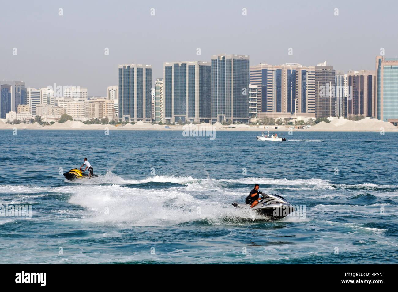 Jetboat Rider in front of the skyline of the Abu Dhabi City, Emirat Abu Dhabi, United Arab Emirates, Asia Stock Photo
